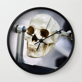 Human skull model in clamps for education Wall Clock