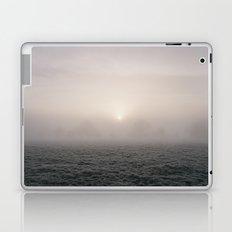 Sunrise through fog on a frosty morning. Norfolk, UK. Laptop & iPad Skin