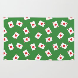 Playing cards hearts suit on green Rug
