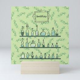 Bottles on shelves Mini Art Print