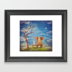 Elephant and rabbit sit on a bench on the glade Framed Art Print