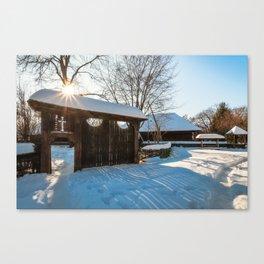 Sun star in a Romanian Village in winter Canvas Print