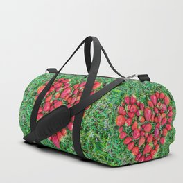 Heart made of strawberries with grass in the background Duffle Bag