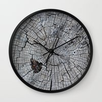 tree rings Wall Clocks featuring Rings by Elizabeth Velasquez