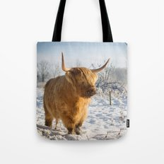 Highland Cow in the snow Tote Bag
