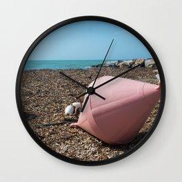 Two big buoys on the beach, azure sea and the rocky beach, Tyrrhenian sea in Tuscany, Italy Wall Clock