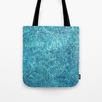 milky way Tote Bags featuring milky way by Motif Mondial