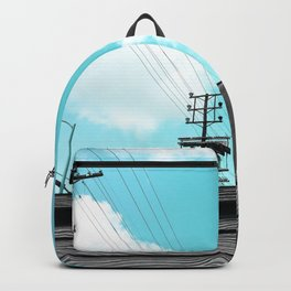 electric pole with wooden wall and blue cloudy sky in the city Backpack