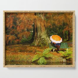 Woman sitting with umbrella Serving Tray