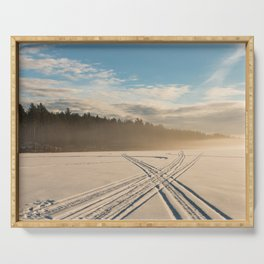 Crossing tracks on snow covered frozen lake Serving Tray
