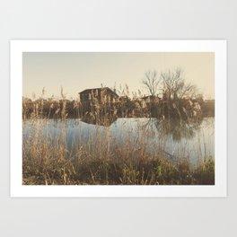 A cottage along a river Art Print
