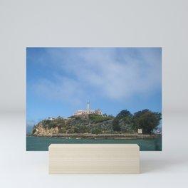 Alcatraz Island is located in San Francisco Bay, 1.25 miles (2.01 km) offshore from San Francisco, California, United States.  Mini Art Print