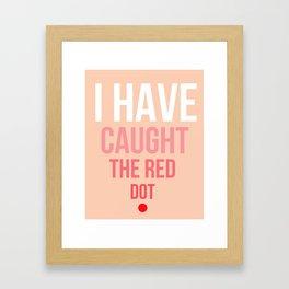 I have caught the red dot. Framed Art Print
