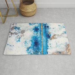 Blue Skies: a pretty, minimal abstract mixed-media piece in blue, white and gold Rug