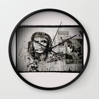 che Wall Clocks featuring CHE by Dave Houldershaw