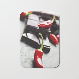 Dark chocolate with chili pepper over wooden background Bath Mat