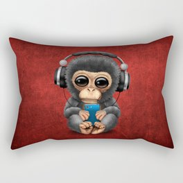 Baby Chimpanzee with Headphones Holding a Cell Phone on Red Rectangular Pillow