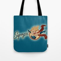 supergirl Tote Bags featuring Supergirl Bombshell by Liquidsugar