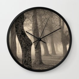 Misty trees of the urban forest Wall Clock