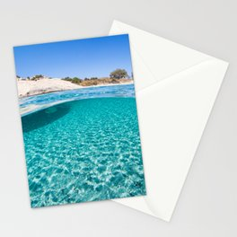 The bottom of an exotic beach on half underwater view Stationery Cards