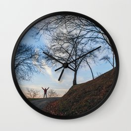 Silhouette at sunset Wall Clock