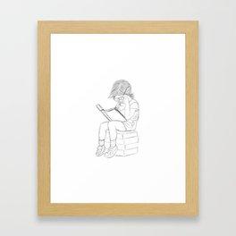 Little girl and her book Framed Art Print