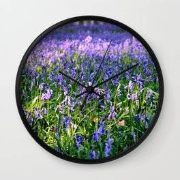 drowning in the bluebell sea Wall Clock