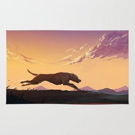 Running at sunset Rug
