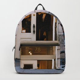Old bicycle parked at luxury fashion store in New York Backpack