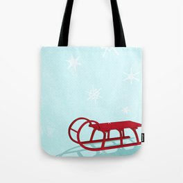 Red sledge in the snow Tote Bag