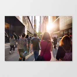 People walking from the work at the street in New York City at sunset time Canvas Print