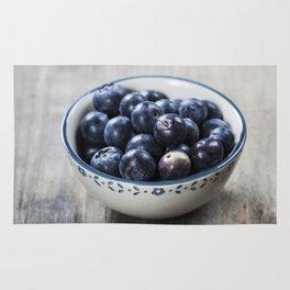 Fresh summer Blueberries on wooden background Rug