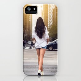 Beautiful girl with long legs walking around New York City street wearing jeans shorts. Rear view. iPhone Case