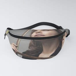Dreamy girl looking through the picture frame Fanny Pack