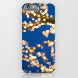 Blurred golden lights Christmas Tree and dark outside iPhone Case