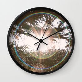 Flare light in the forest Wall Clock