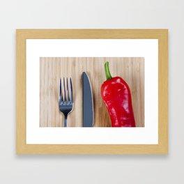 Red pepper on chopping board Framed Art Print
