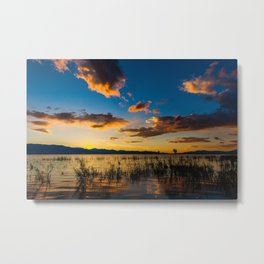 Sunset clouds over lake Metal Print