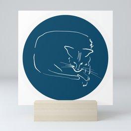 Relaxing Cat in blue circle Mini Art Print