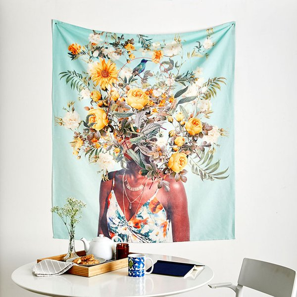 tapestry of woman with flowers hanging over a desk