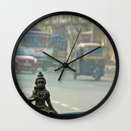 Gods are where you find them Wall Clock