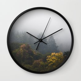 Autumn forest wrapped in fog Wall Clock