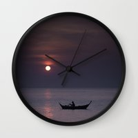 rowing Wall Clocks featuring Rowing into the sunset by Maria Heyens