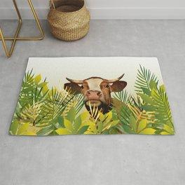 Cow looking between leaves Rug