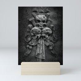 Three Skulls On A Tombstone Mini Art Print