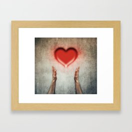 heart holding Framed Art Print