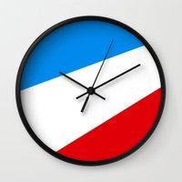 tour de france Wall Clocks featuring Tour de France by Anastase Kyriakos