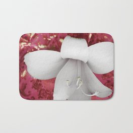 Innocent in rose Bath Mat