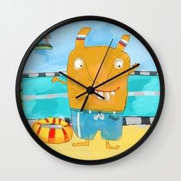 Cute Creature in the pool Wall Clock