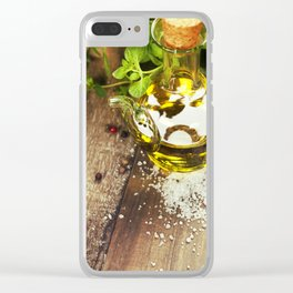 Olive oil,  herbs and spices on a wooden table Clear iPhone Case